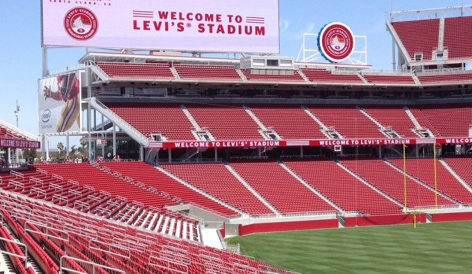 Levi Stadium with sign welcoming fans and red seats and green field