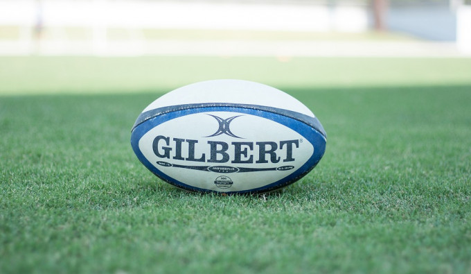 Rugby Ball on a green grass field