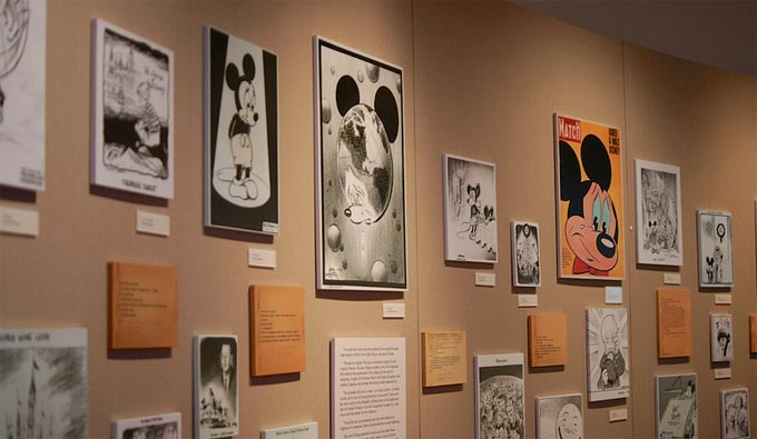 Walt Disney Family Museum. Historic drawings of Mickey Mouse line the wall