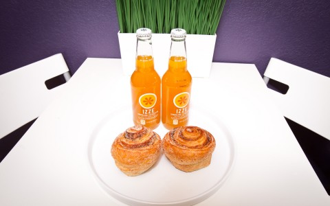 2 Izzy's orange soda's and cinnamon rolls.