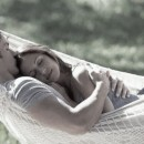 a couple laying in a hammock