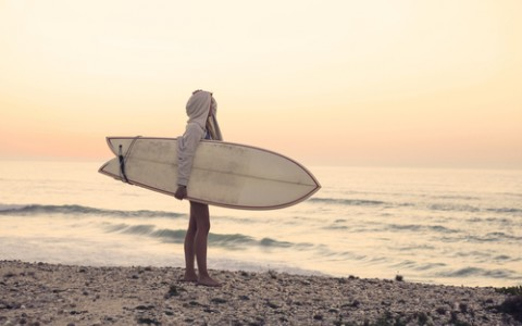 Girl Looking at Waves with Surfboard