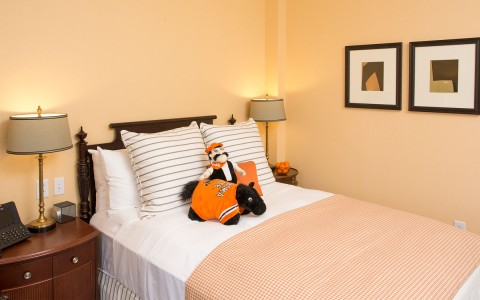 Bed with OSU mascot in the center