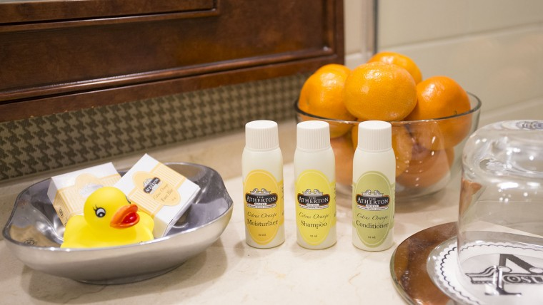Bathroom Amenities and Oranges on Bathroom Counter