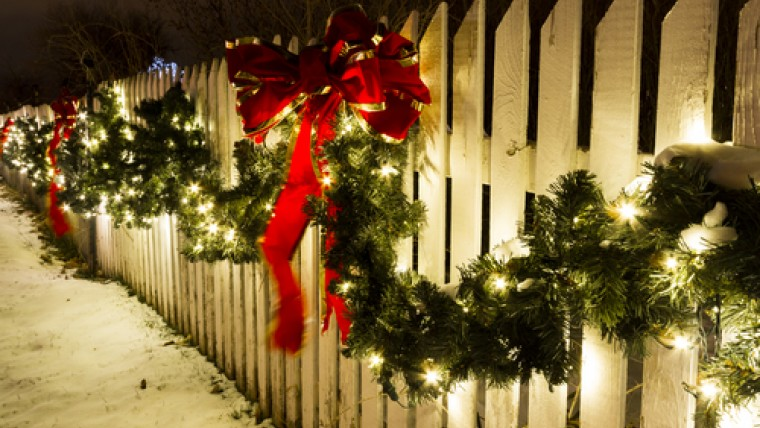 Christmas Lights and Holly on White Picket Fence
