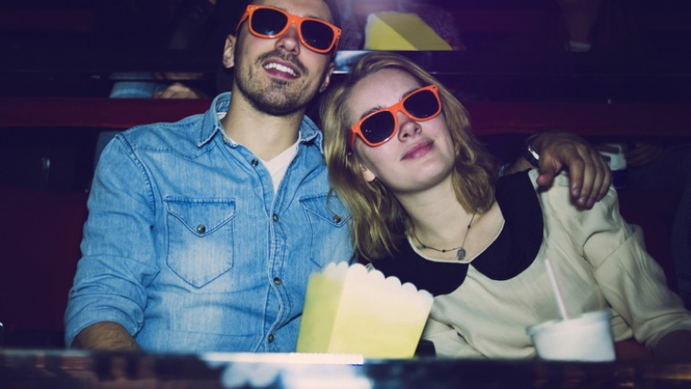 couple in orange glasses at movie theater