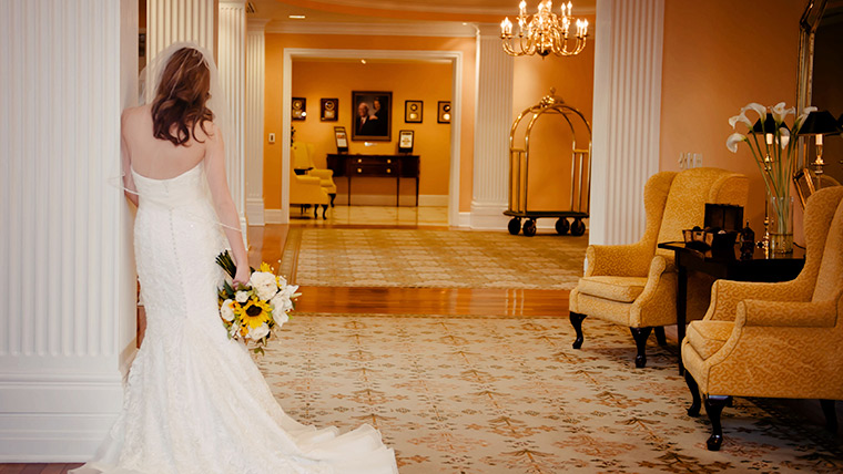 Bride in the Foyer of the Hotel with a Bouquet in Hand