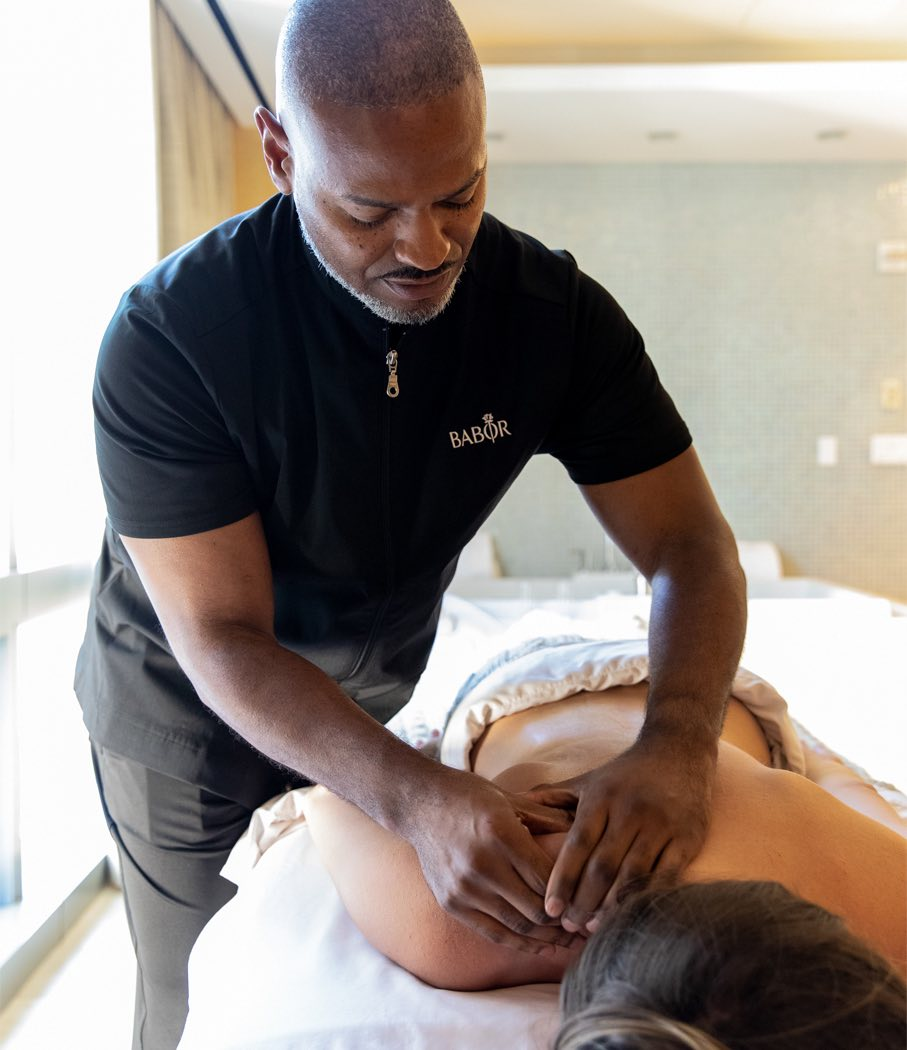 man giving a woman a back massage