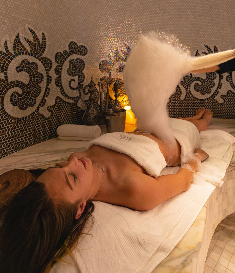 woman receiving a hammam circuit treatment