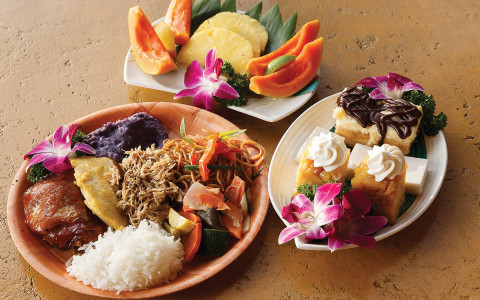 Luau Kalamaku*https://www.luaukalamaku.com/*A meal is elegantly presented with a side of fruits and deserts