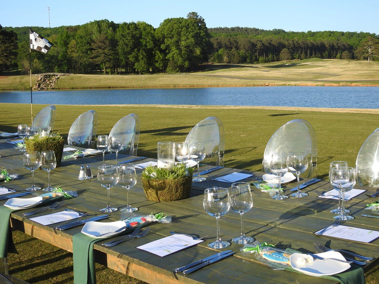 wedding reception set up on the tenth tee golf course overlooking lake