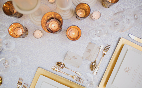 overhead view of beautiful wedding able setting with gold and lace accents