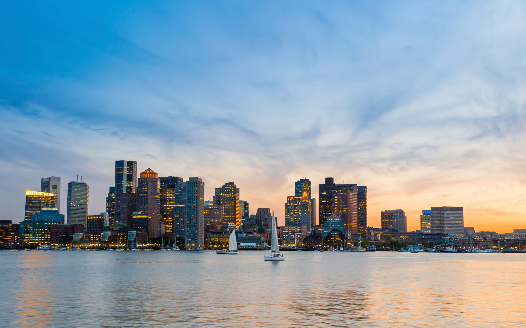 boston skyline from the water at sunset