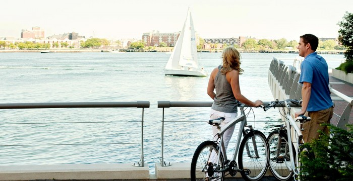 man and woman with bikes by the water