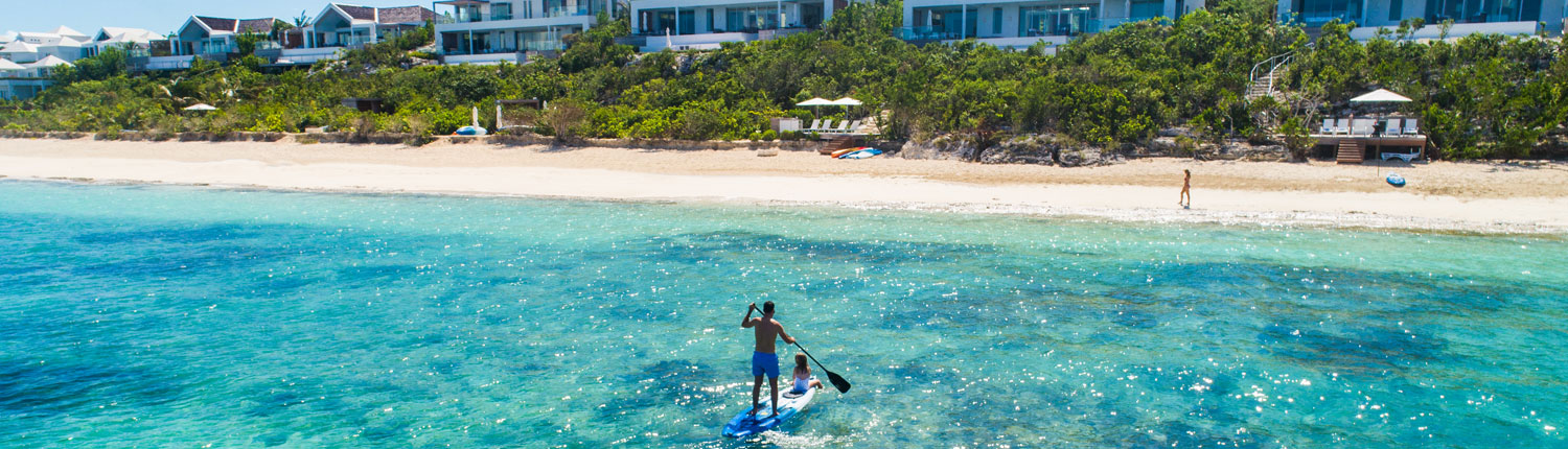 man paddle boarding in the ocean