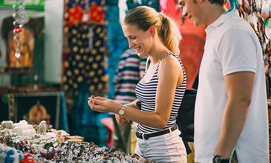 Woman browsing nicknacks at Festival Flea Market
