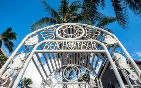 Entrance metal arc with beachcomber sign