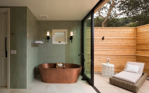 Copper tub next to outdoor patio area