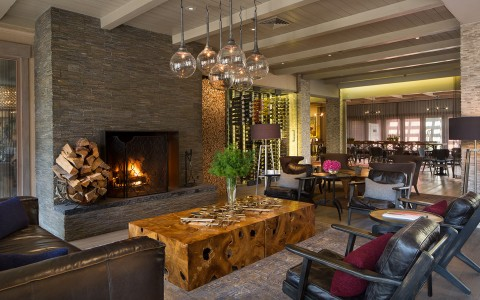 Sitting area with leather chairs and stone fireplace