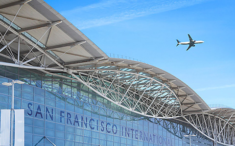 San Francisco International airport with an airplane above it