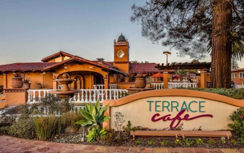 Terrace Cafe sign with the Terrace Cafe building in the background