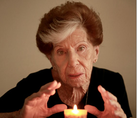 Woman staring at you over candle flame