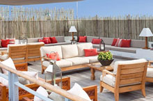 deck chairs and sofas with red pillows