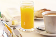 glass of orange juice and cup of coffee