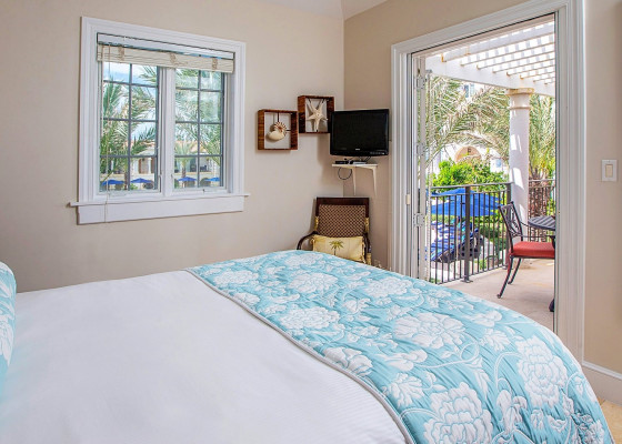 queen bed with porch view