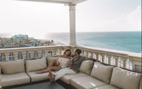Couple lounging on balcony