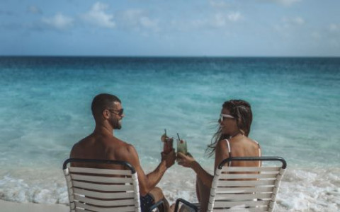 Couple on shore with drinks