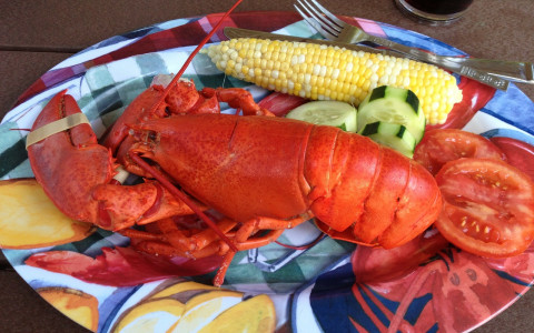 Plate of lobster corn and tomatoes