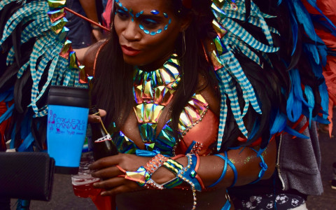 carnival dancer with feather costume