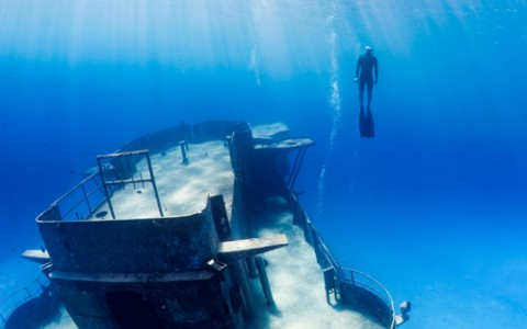 underwater shipwreck and freediver