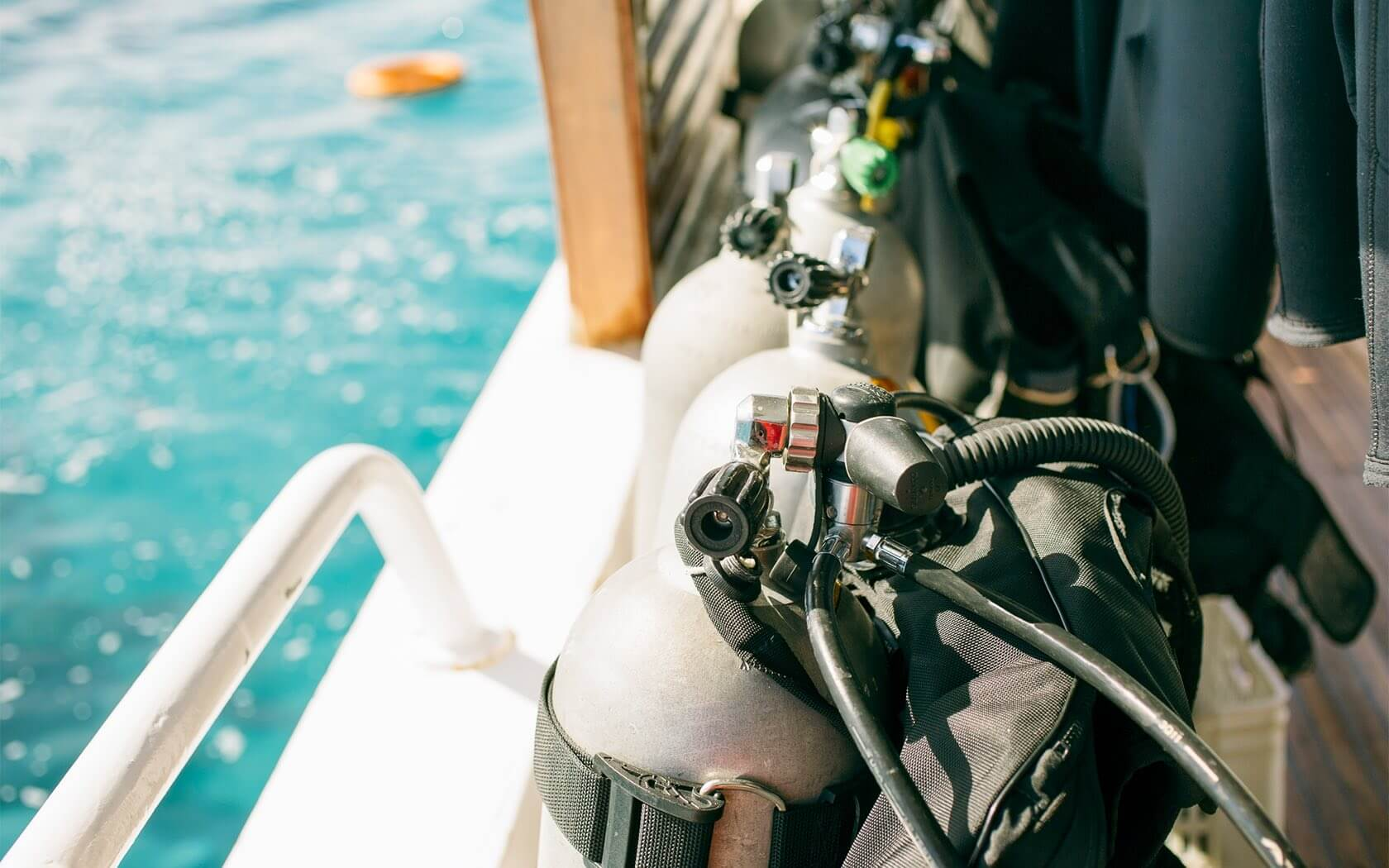 close up of two scuba diving tanks on a boat