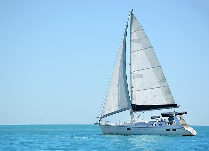 A sailboat cruising on the water
