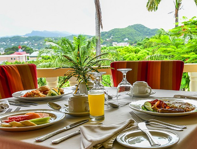 breakfast set on a guest room patio table overlooking the mountains