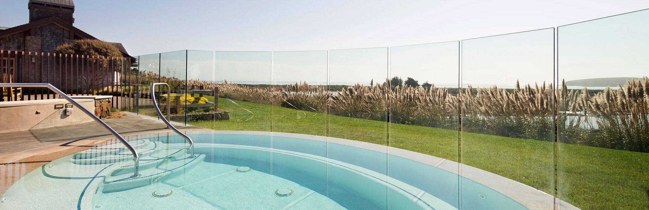 Enclosed room outdoor hot tub with see through panels to the outdoors