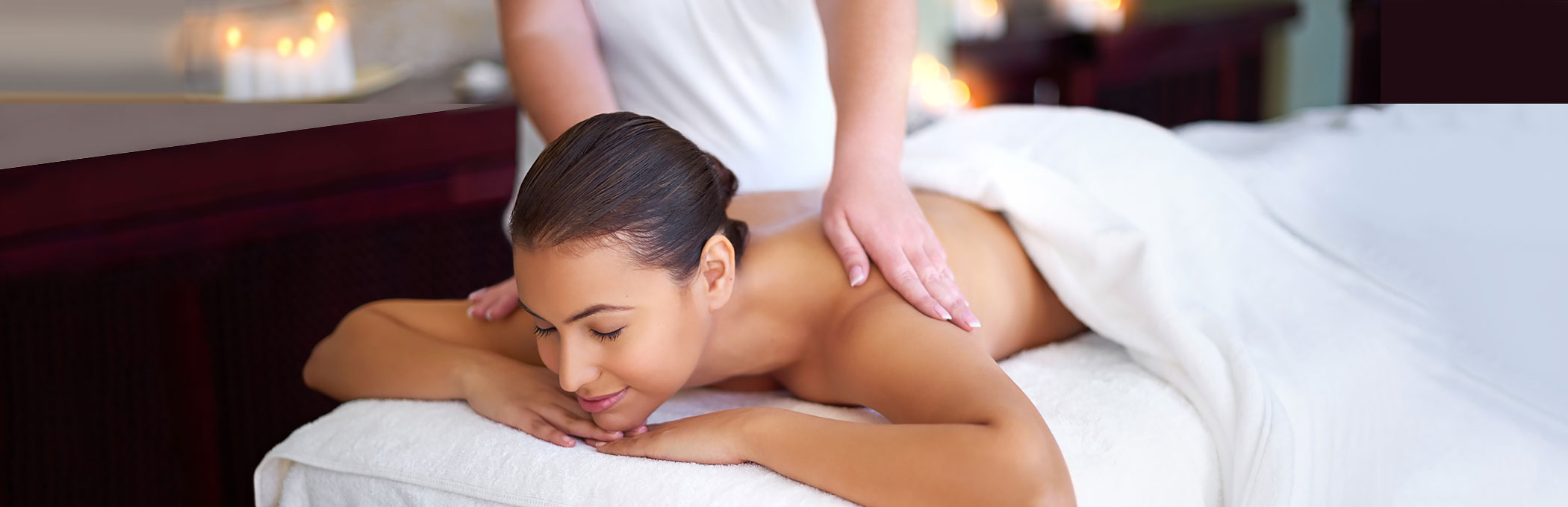 Woman laying down on spa bed getting massage