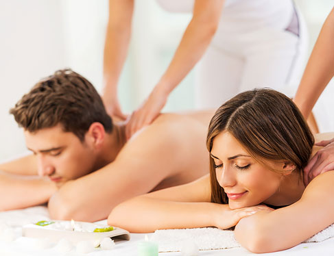 Couple laying down & getting massage together