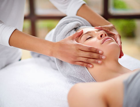 Woman laying down in spa getting a facial