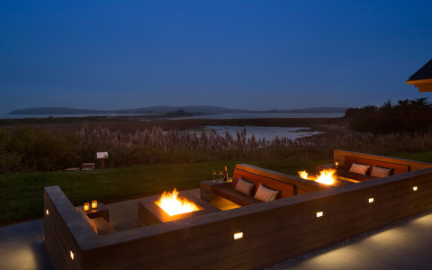 drakes firepit lounge in the evening overlooking Doran beach