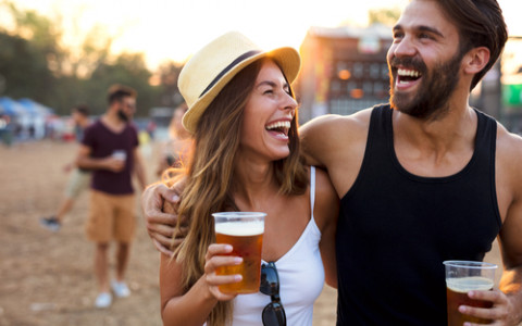 Couple Laughing with Beers