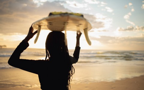 surfer holding board