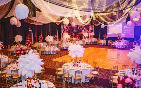 ballroom set up for an event with a dance floor