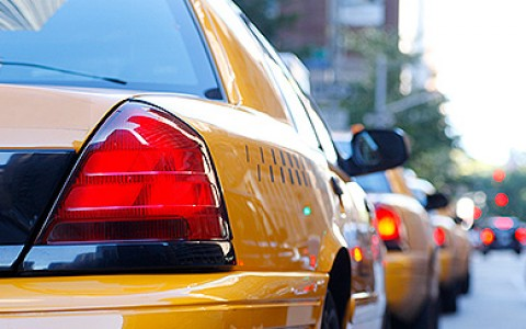 Close up of a New York City Taxi in traffic
