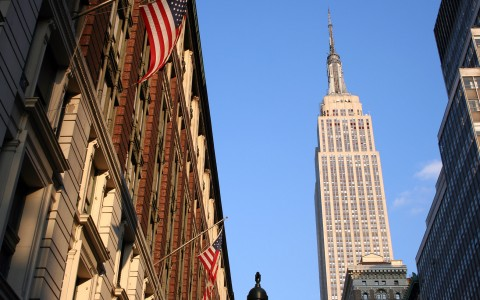 new york buildings with american flag flying