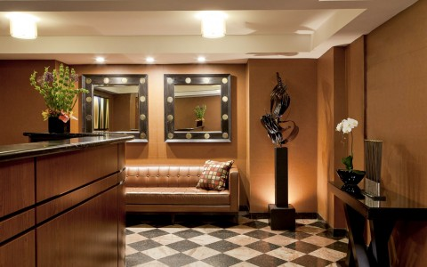 lobby with brown leather sofa and reception desk