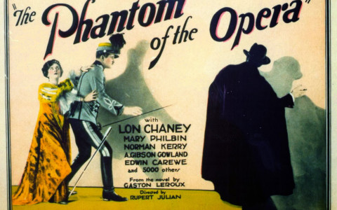 Phantom of the Opera old movie poster with phantom man and woman as well as names of the stars of the show