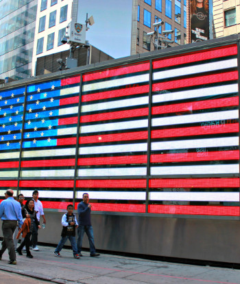 memorial day flag displayed electronically on side of metal building in Times Square